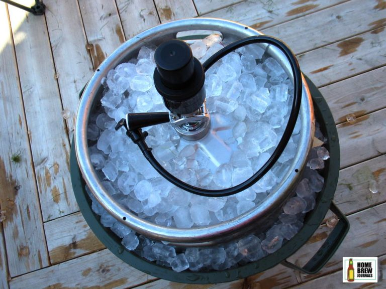 A beer keg in a trash can full of ice, photo to illustrate how to keep a keg cold without a kegerator